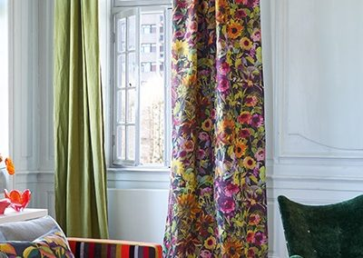 Stripe sofa with floral curtains - Fabric by Designers Guild