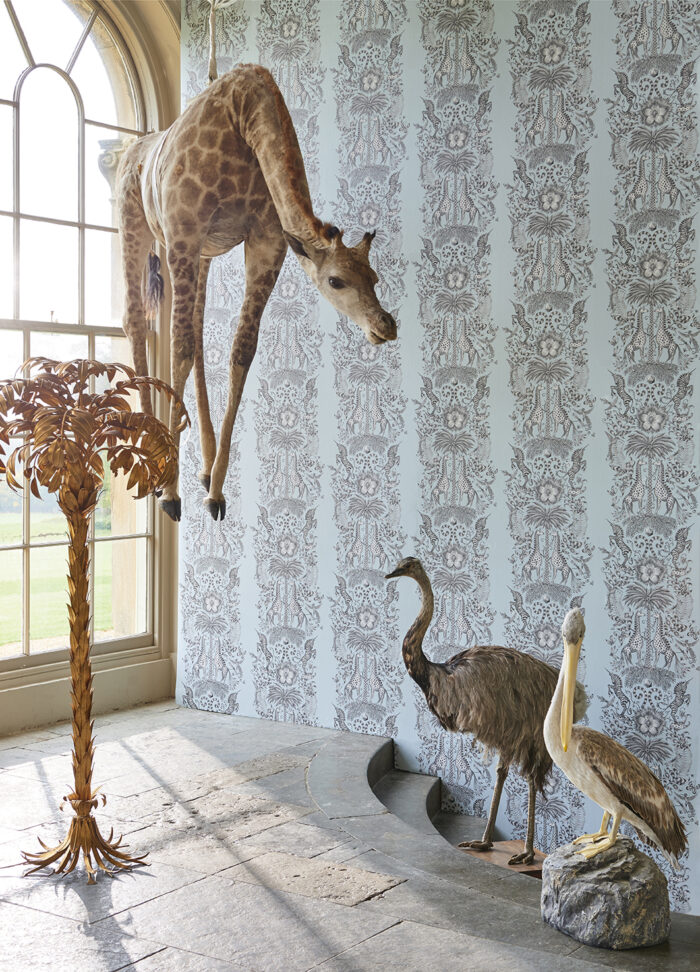 Room Shot showing the Kruger wallpaper from the Animalia Wallpaper colleciton designed by Emma J Shipley for Clarke & Clarke