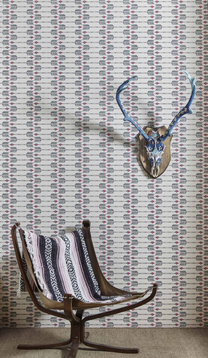 Room shot of Arrow wallpaper in charcoal and pink by Barnaby Gates
